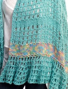 Yarnspirations.com - Caron Tunisian Wrap    The unique, traditional crochet work of this versatile wrap will make it a new favourite in your wardrobe.