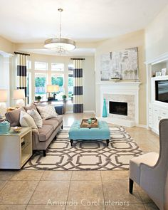 Grey + Taupe + off-whites + pop color (teal). I loved this Living room as soon as I saw it, without knowing why. Bold patterns against solid furniture + light + roomy = comfortable and modern