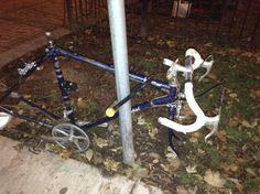 The infamous public art bike has now lost its front wheel. That officially makes it junk