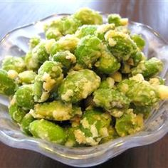 Crispy Edamame - Rinse/thaw a frozen package of shelled edamame beans, spread into baking dish, drizzle with 1 TBSP olive oil and sprinkle with 1/4 c parmesan, salt and pepper. Bake for about 15 min until cheese is crispy and golden.