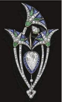 Boucheron's Art Deco Lotus Flower pin made of Diamonds, Sapphires and Emeralds via Jewelry Nerd