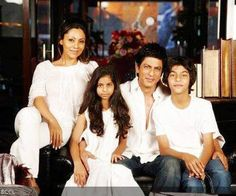 Shah Rukh Khan poses with wife Gauri, son Aryan and daughter Suhana during the shoot of a magazine.