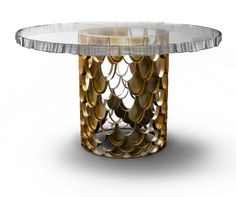 The base of the Koi Dining Table, with scales of brass, shine like that of a Koi fish  as the sun catches through the clear water | domino.com