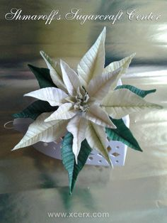Hey everyone. Here is my step bu step of how to create live like poinsettia. If you wish to make red one use ready to use red flower paste. The instructions are in Bulgaria :) but I hope picture will help you. I used in rose petal cutters for...