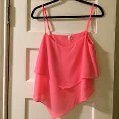 Hot pink tiered tank Hot pink 2-tiered tank top. Hem comes to a point in the middle Ekklesia Tops Tank Tops