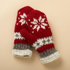 SNOWFLAKE MITTENS -- Keep hands toasty warm with our hand‑knit mittens made of New Zealand wool and lined with super soft fleece. Machine wash. Imported. One size fits most adults.