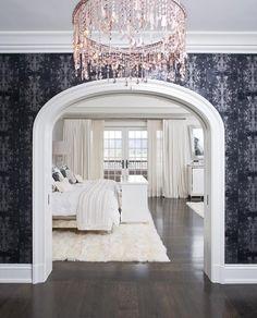 Dramatic light fixture and doorway into the bedroom