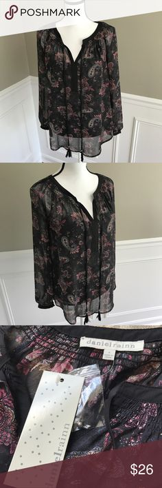 New NWT Daniel Rainn black Paisley shirt Blouse New with tags attached never worn Daniel Rainn Women's Sz Small shirt. Flowy style. Long sleeve. Semi sheer with built in black cami underneath. Paisley pattern. Smoke free pet free home. Measures 19 inches across pit to pit, 25.25 inches length. 26 inches sleeve length. Tassel accent on front. Daniel Rainn Tops Tunics