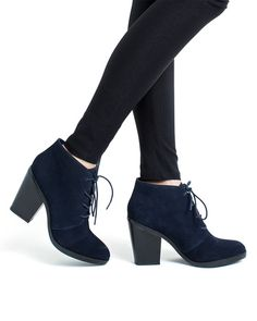 Dressed up or down, this is a lace-up bootie to swoon over. Available in navy suede or Dalmatian pony hair