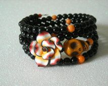 Day of the Dead Orange Skull, Polymer Clay Rose Flower, with Black and Orange Beaded Memory Wire Bracelet