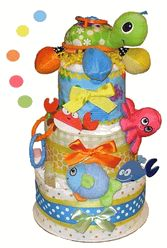 """Sea Life Diaper Cake - This fun, colorful 3 tier Sea Life Diaper Cake (Under The Sea Diaper Cake) features a sweet plush activity Turtle stroller toy and is """"loaded"""" with high quality baby items and of course, lots of diapers! The new parents will be delighted to receive this impressive Sea Life Diaper Cake."""