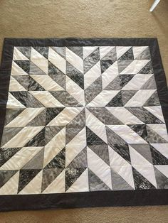 Black and White Starburst This quilt is very vibrant, and makes a great accent for the room. Black, grey, and white in a star-burst design. This measures 56 square. Can be machine wash and dry on gentle cycle. Quilt Baby, Baby Quilt Patterns, Quilts For Men Patterns, Quilting Patterns, Half Square Triangle Quilts Pattern, Square Quilt, Star Quilt Blocks, Star Quilts, Big Block Quilts