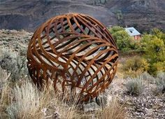 "From Mr. Hosey's web gallery  ""The 8-foot steel spheres are the beginning of a new dimension.  Despite the heavy weight of these steel spheres they look buoyant.""  http://www.bernardhosey.com/gow_spheres_2.htm"
