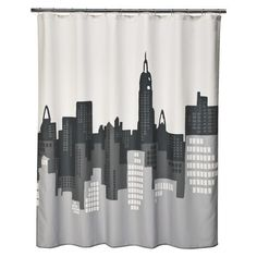 Cityscape shower curtain for superhero bathroom. Thanks, Target! Wish it were fabric, though.