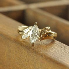 Pre-owned engagement ring crafted in 14 karat yellow gold and graced with a .70…