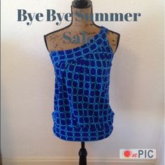 """LAST CHANCE! ONE SHOULDER TOP IN BLUE & AQUA LAST CHANCE! DONATING 9/24! One shoulder top in cobalt blue & aqua. Preppy, Window pane/chain print, size S - 17"""" armpit to armpit, 25"""" shoulder to bottom, bottom band is flattering to figure. 100% Rayon, in excellent condition - worn 1 x. Non smoking home, no trades. 020216.  12 New York & Company Tops"""