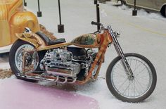 """Norm Grabowski's epic """"Six Pack"""" — an air-cooled, flat-six Corvair-powered motorcycle with a very over-the-top 1970s looking airbrush paint job."""