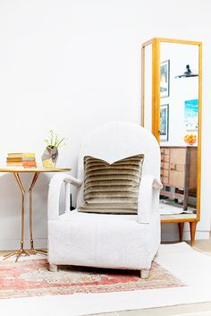Home Tour: Inside a Colorfully Eclectic Family Home// bird table, layered rugs, Meret Oppenheim table