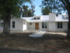 A transformed ranch house. I like the board and batten exterior, good idea for new roof