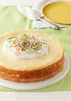 Floribbean Lime Cheesecake – What's a Floribbean Lime Cheesecake? Think coconut, cream cheese, and citrusy deliciousness in a scrumptious cookie crust.