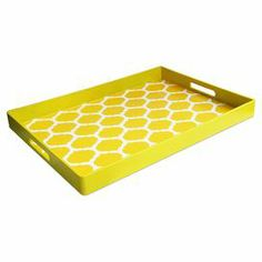 """Tray in yellow with a Moroccan trellis motif and cut-out handles.    Product: TrayConstruction Material: PolypropyleneColor: YellowDimensions: 2"""" H x 19"""" W x 14"""" DCleaning and Care: Hand wash"""