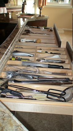 2nd floor - Kitchen - Range wall - lower cabinet top drawers (E1-F1-G5) - Place utensils separated by use: silverware, cooking, serving, knives, etc - if not enough utensils/knives G5 can hold dish towels, pot holders, etc