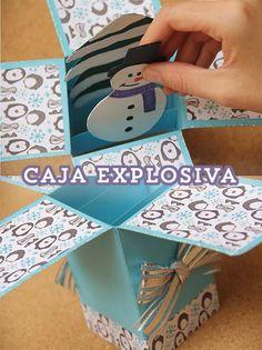 Caja explosiva navideña con un hombre de nieve dentro, es perfecta para regalito y sorprender a la persona. Utiliza papel deco de craftingeek.me para decorarla.