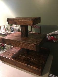 I was asked to make a cupcake stand for my stepdaughters wedding.  I built this using Pallets and a fence post.
