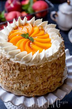Peaches and Cream Cake Recipe - Easy Dessert made of Soft layers of Sponge Cake with Chunky Peach Preserve and lightly sweetened Whipped Cream. Roasted Almonds add a nice pleasant crunch for a textural contrast. Yellow Sponge Cake Recipe, Peaches And Cream Cake Recipe, Peach Cake Recipes, Sponge Cake Recipes, Sweet Recipes, Peach Layer Cake Recipe, Chocolate Chip Cake, Chocolate Recipes, Easy Desserts
