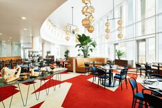 The 53 rooms of The Durham Hotel—a midcentury-modern boutique hotel in the heart of downtown Durham—are decked out in the bold Bauhaus colors of yellow, red, and blue.
