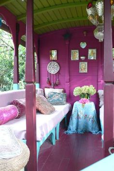 Romani caravan in bright purple with splashes of turquoise & chartreuse - designed by Jeanne Bayol Gypsy like.