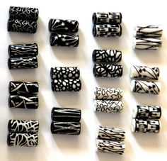 I've been designing paper tube beads inspired by Zentangles/zendoodles. I made 14 pairs in total: