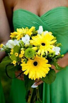 Emerald green bridesmaid dress with popping yellow Gerber daisy bouquet