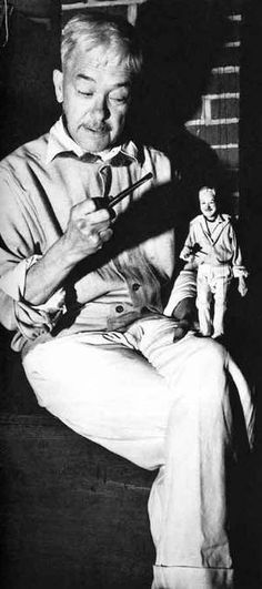 Dwiggins with a puppet of himself, by Randall W. Abbott