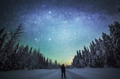 """Finnish artist Tiina Tormanen photographs vast snowy arctic landscapes. For her project """"Wanderer"""", a faraway silhouette is photographed in the middle of these deserted landscapes, contemplating the huge starry sky. A series full of magic, to discover."""