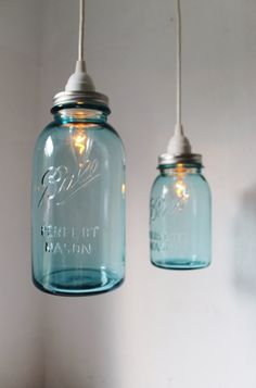 2 antique blue Mason jars have found new lives as beautiful hanging pendant lamps.    One half-gallon and one quart jar pair perfectly, adding style and charm to any room. These lights are perfect over a kitchen island or table, in the living room for accent light, in the bedroom for reading, or in the bathroom for unique and fun lighting!    Our lights have been featured in Country Living Magazine, Natural Home and Garden Magazine, Flea Market Style Magazine, British GQ Magazine and…