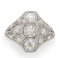 Diamond Ring   Platinum, 13 diamonds ap. 1.00 ct., c. 1915, ap. 3.2 dwt.