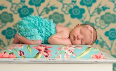 Sweet sleeping baby...in love with the background color/pattern...so cute!