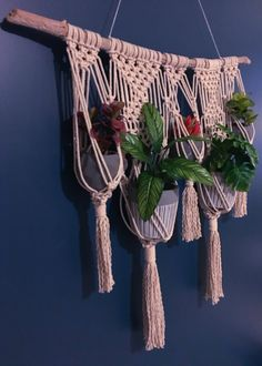 This macrame wall plant hanger was handcrafted on a piece of driftwood found along the shores of Maine. It is made of 100% cotton rope and natural wood. The hanging measures approximately 34 wide including the driftwood (26.5 without) and 48 long including the string to hang (31.5 without). There are five baskets for plants to be placed. ***THIS PLANT HANGER HAS SOLD***If you purchase this listing, you are buying a replica of this design, however the driftwood will be slightly different…