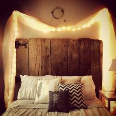 Reclaimed timber gate as headboard. Gorgeous lights and cushions. Such a dreamy room. I want to sleep here!