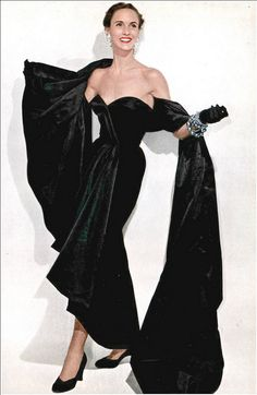 1950 Mrs. Amory S. Carhart, Jr. in black velvet strapless evening gown with accompanying long stole, by Christian Dior, Vogue,