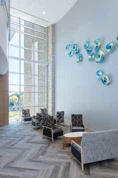 The aesthetic for WellStar Vinings Health park was inspired by nature to make the environment approa Lobby Design, Holistic Wellness, Window Wall, The Expanse, Natural Light, Wall Decor, Park, Calming, Health