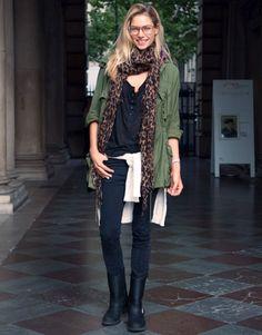military jacket. leopard scarf. black shirt. skinny jeans.
