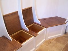 This has a wrap around bench seat with individual lift up lids. Includes separate storage in bench and in cubbies above. Made from poplar hardwoods with a premium hand painted finish. V-groove planking is used for backer, and custom partitions for the hangup area. Custom made to fit your space, and the lid can be stained to match flooring or anything you desire.