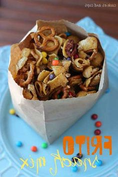 Frito Snack Mix: fritos, Chex Cereal, pretzel twists, nuts, light brown sugar, butter, light corn syrup, mini m&ms