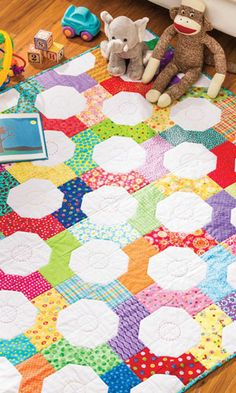 Bow Tie Baby Play Mat in the Summer 2014 Issue of Quilter's World