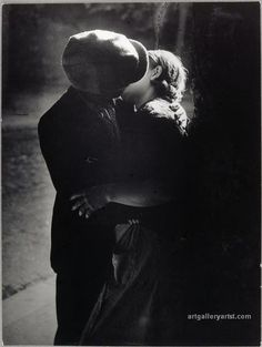 Brassaï: 'Paris By Night 1932'. http://www.photo.rmn.fr/archive/00-021272-2C6NU0VS3TVZ.html  http://www.photo.rmn.fr/C.aspx?VP3=SearchResult&VBID=2CO5PC0VY5S7A&SMLS=1&RW=1820&RH=1118#/SearchResult&VBID=2CO5PC0VY5S7A&SMLS=1&RW=1820&RH=1118&PN=3  http://www.atgetphotography.com/The-Photographers/BRASSAI.html (not by Henri Cartier-Bresson http://indulgy.com/post/fW9N2stjC1/henri-cartier-bresson#/do/page/1 )