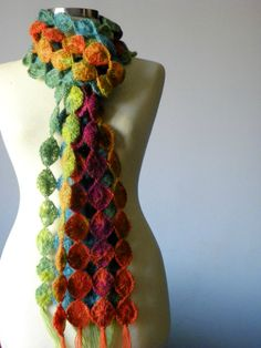 This crocheted scarf is so beautiful with it's diamond shapes and gorgeous colors! And it's perfect when it's cool, but not too cold- not stifling and thick like most scarves!