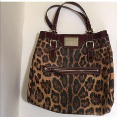 Authentic Dolce & Gabbana tote This listing is for an authentic Dolce & Gabbana  oversized shoulder bag from the Anamilier collection. Leather is in great condition, the cranberry straps are showing some wear. I will be listing this at a low er price elsewhere. Dolce & Gabbana Bags Shoulder Bags