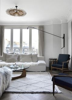 great inspiration for my living room makeover: love the white, brass, and navy